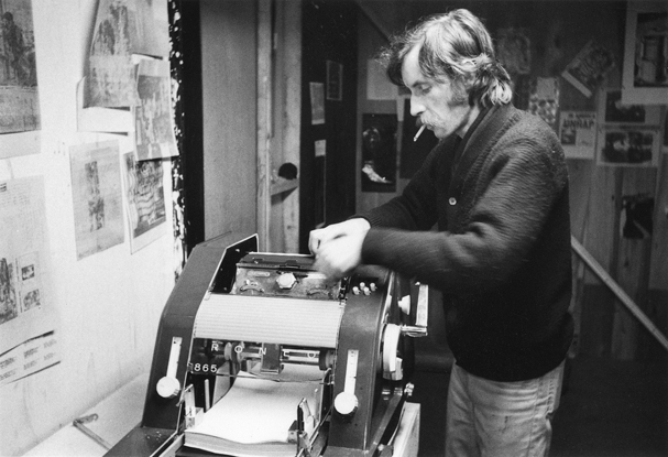 Gerry Gilbert using the Roneo Machine