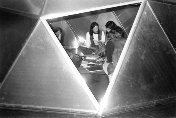 Poetry Front: Poet and group in aluminum sheet dome